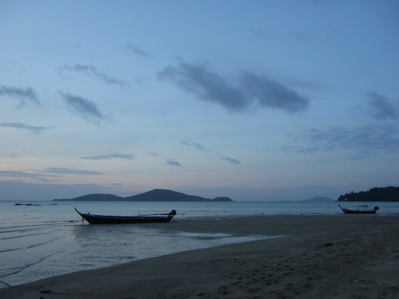 Fishing boats at the beach at sunrise in Phuket, Thailand